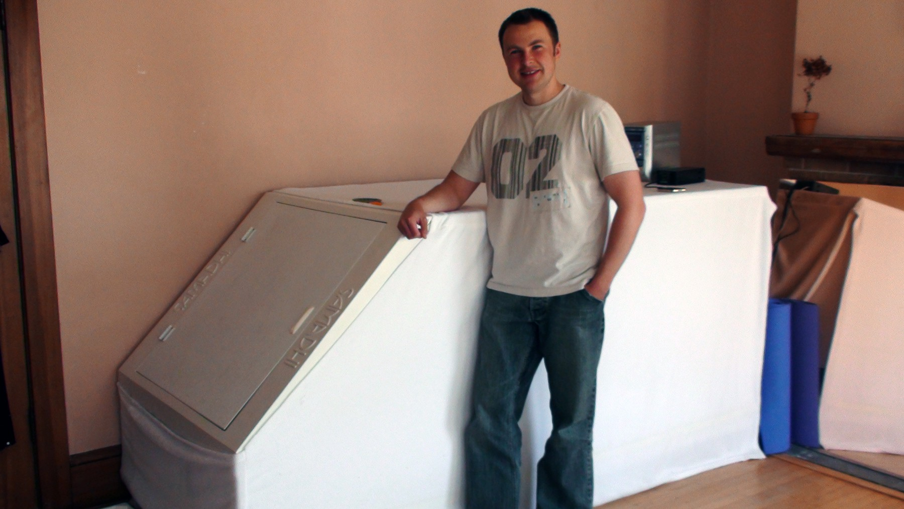 Ernest Semerda next to the classic design of a Isolation Tank